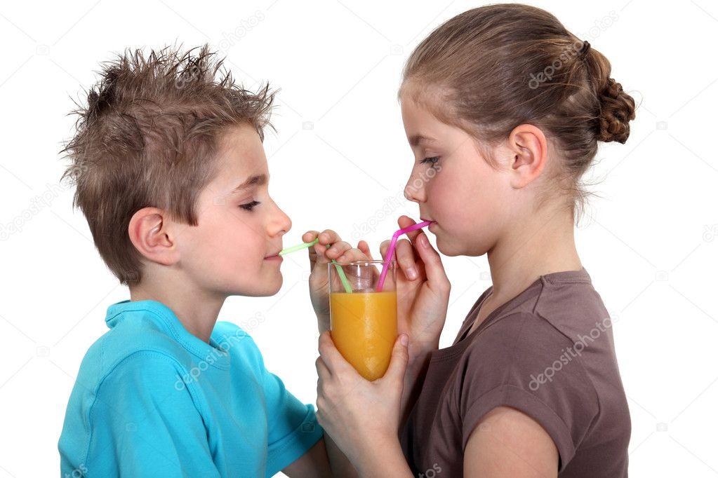 depositphotos_8059590-stock-photo-two-children-sharing-orange-juice